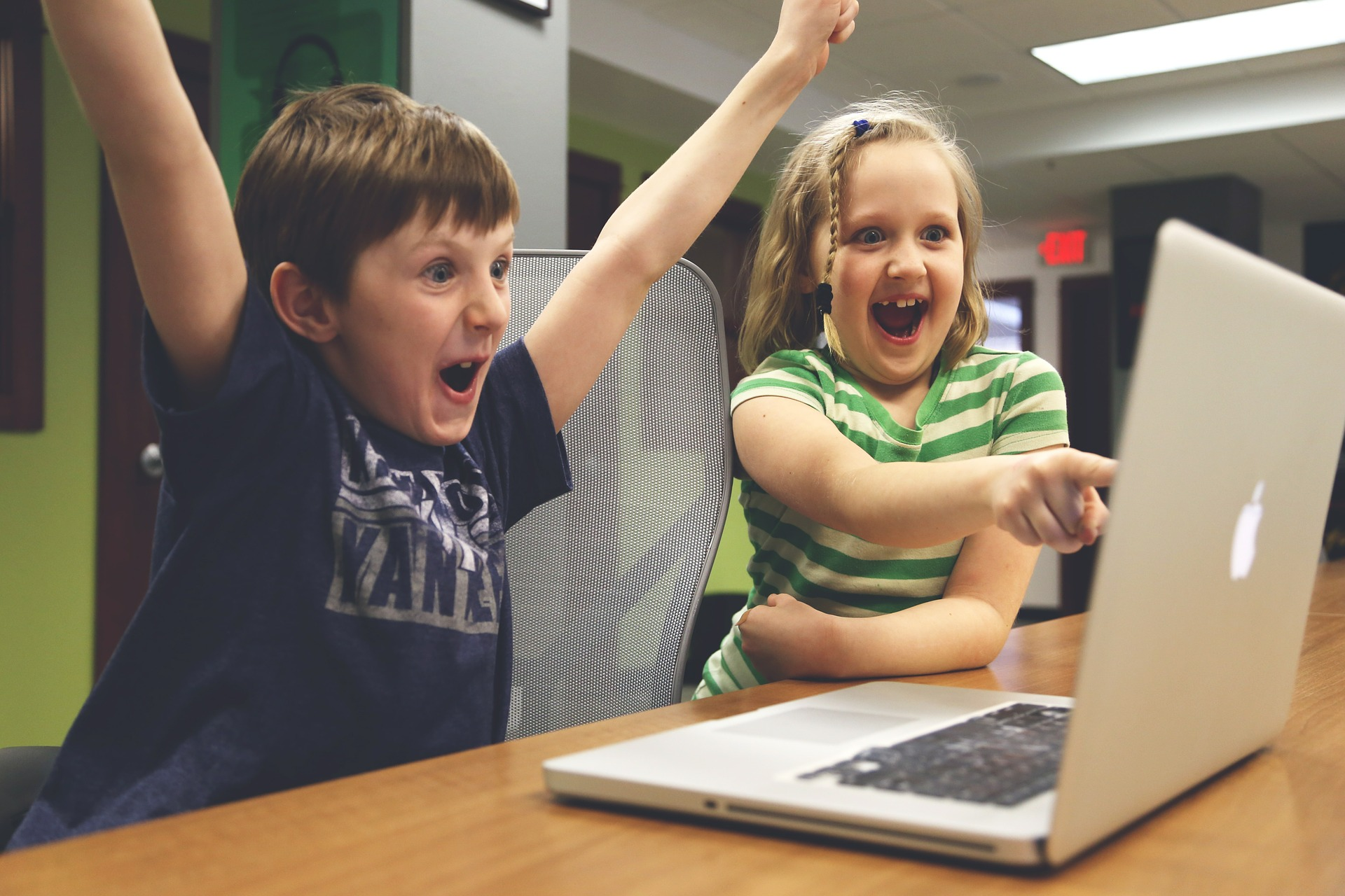 Kids excited at computer
