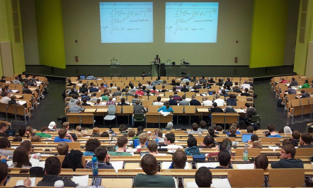 Teacher at the front of a lecture hall